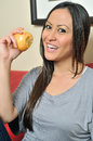 Beautiful biracial woman eating an apple Royalty Free Stock Photos