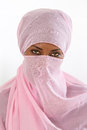 Beautiful black african muslim woman wearing pink headscarf young red Stock Photo