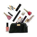 Beautiful black makeup bag and cosmetics isolated on white background Stock Images