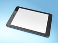 Beautiful black tablet pc on blue background Stock Photo