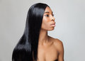 Beautiful black woman with long straight hair young Stock Photo