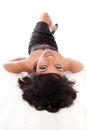 Beautiful black woman lying down Stock Photos