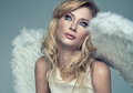 Beautiful blond angel portrait of Stock Photo