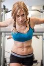Beautiful blond caucasian woman exercising Stock Images