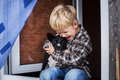 Beautiful blond child embrace his dog. Friendship between human and animal Royalty Free Stock Photo
