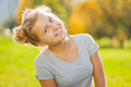 Beautiful blond girl close-up view in park Royalty Free Stock Photo