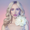 Beautiful blond girl with flower fashion portrait of spring colorful make up beauty young woman Stock Image