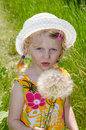 Beautiful blond girl in hat and flower image Stock Image