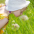 Beautiful blond girl in hat and flower image Royalty Free Stock Photography