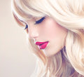 Beautiful blond girl with healthy long wavy hair white hair Stock Photos