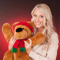 Beautiful blond girl holding a teddy bear young woman christmas Stock Photo