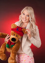 Beautiful blond girl holding a teddy bear young woman christmas Stock Photography