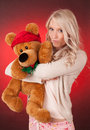 Beautiful blond girl holding a teddy bear young woman christmas Royalty Free Stock Photos