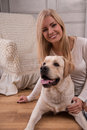Beautiful  blond girl with Labrador Retriever Royalty Free Stock Photo