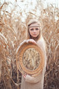 Beautiful blond girl with a mirror in the reeds Stock Image