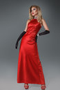 Beautiful blond girl in red dress Royalty Free Stock Images