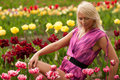 Beautiful blond girl with tulip flowers amazing spring photo from latvia baltic states europe Stock Photography