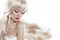 Beautiful blond with long hair. Makeup. Sensual woman with blowi Royalty Free Stock Photo