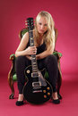 Beautiful blond sitting with electric guitar Stock Photo