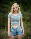 Beautiful Blond Teen Showing Belly Button Royalty Free Stock Photo