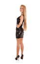 Beautiful blond woman in black shiny dress Stock Image