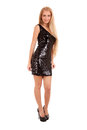 Beautiful blond woman in black shiny dress Royalty Free Stock Image