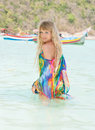 Beautiful blond woman in colorful tunic relaxing in the sea