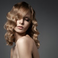 Beautiful blond woman curly long hair elegant Royalty Free Stock Photography