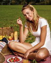 Beautiful blond woman enjoying a pick nick outdoors Royalty Free Stock Image