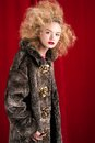 Beautiful blond woman in a fur studio shot Royalty Free Stock Photos