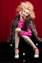 Beautiful blond woman in a fur studio shot Stock Photo