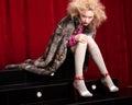 Beautiful blond woman in a fur studio shot Stock Photos
