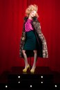 Beautiful blond woman in a fur studio shot Royalty Free Stock Image