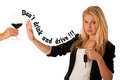 Beautiful blond woman gesturing don't drink and drive gesture, with refusing a glass of red wine isolated over white Royalty Free Stock Photo