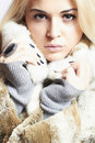 Beautiful blond woman girl in mink fur coat winter fashion portrait of Royalty Free Stock Photo