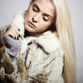 Beautiful blond woman girl in mink fur coat winter fashion portrait of Royalty Free Stock Image