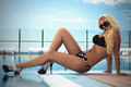 Beautiful blond woman in high heels.girl in bikini and sunglasses.blond sexy woman in high heels Royalty Free Stock Photo