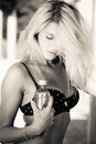 Beautiful blond woman holding bottle of water Royalty Free Stock Photo