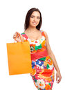 Beautiful blond woman holding shopping bags Royalty Free Stock Image