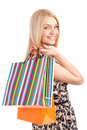 Beautiful blond woman holding shopping bags isolated over white background Stock Photo