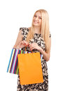 Beautiful blond woman holding shopping bags isolated over white background Royalty Free Stock Photos