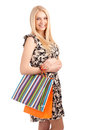 Beautiful blond woman holding shopping bags isolated over white background Stock Image