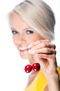 Beautiful blond woman holding two ripe cherries Royalty Free Stock Photo