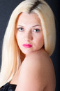 Beautiful blond woman portrait and straight long hair over black background Stock Photos