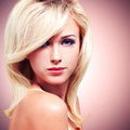 Beautiful blond woman with style hairstyle closeup face of young glamour white hairs over art background Stock Images