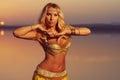 Beautiful blonde belly dancer woman