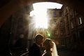 Beautiful blonde bride hugging handsome happy groom at sunset, n Royalty Free Stock Photo