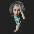 Beautiful blonde with bright makeup and jewelry fashion photo of a Royalty Free Stock Photography