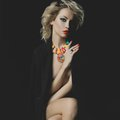 Beautiful blonde with bright makeup and jewelry fashion photo of a Stock Image