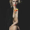 Beautiful blonde with bright makeup and jewelry fashion photo of a Royalty Free Stock Photos
